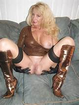 In Stockings And Heeled Boots Showing Off Her Delicious Groomed Pussy
