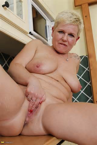 Mature Blonde Playing With Her Pussy